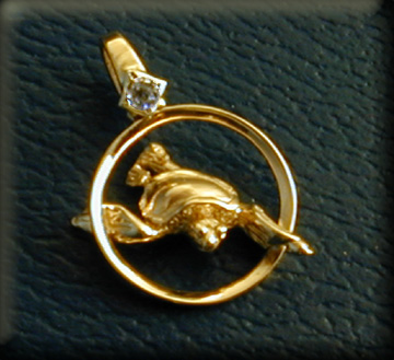 14k yellow gold swimming turtle  pendant with diamond accent